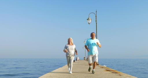 Senior couple having morning jog with music GIF 動畫