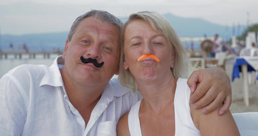 Couple Sticking Moustaches to Each Other Faces Footage