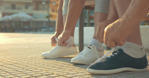 Mature couple lacing running shoes before jog Footage