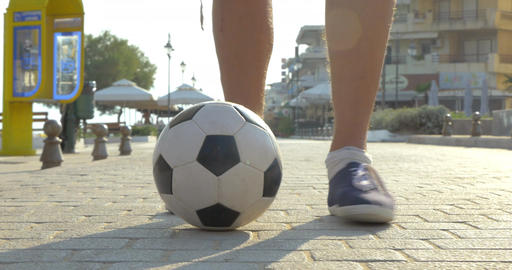 Man dribbling a football outdoor Footage