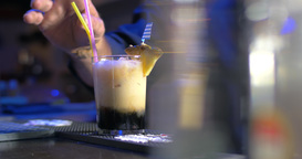 Barman Putting Straws into Glass with Cocktail Footage
