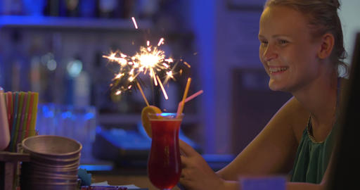 Woman with Smartphone Ordered Cocktail with Sparkler Footage