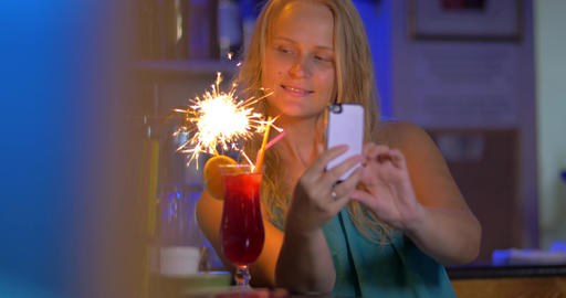 Woman making selfie with cocktail and sparkler Footage