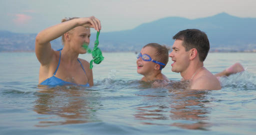 Family having with toy frog in the sea Footage