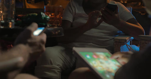 Three people using their phones and tablet in cafe ライブ動画