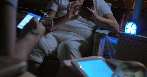 Three people using devices ライブ動画