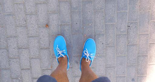 Timelapse of male feet walking on sidewalk Footage