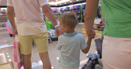 Family walking in toy shop Footage