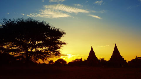 Silhouette of Temples and tree in Bagan at sunset Footage