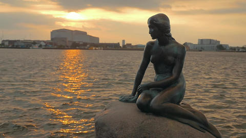 Mermaid statue on the stone in sea at sunset Footage