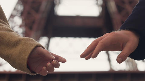 Shy couple holding hands with tender, first date, beginning of love relationship Footage