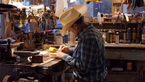 Artisan At Work In Traditional Cowboy Shop In Texas USA Live Action
