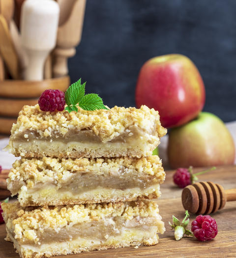 square baked pieces of cake with apples Photo
