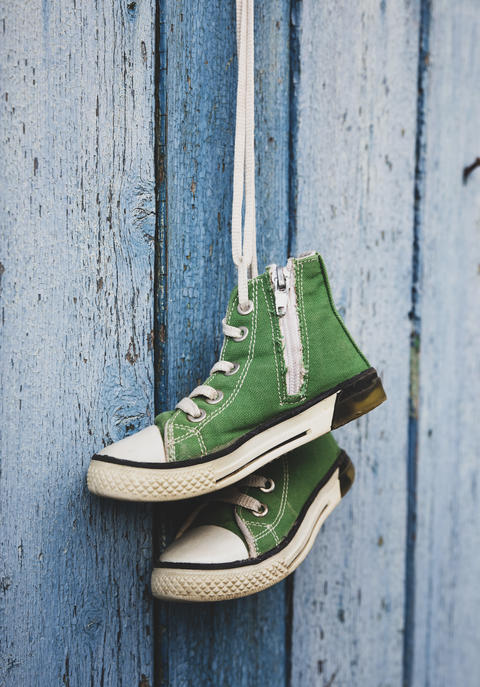 pairs of old textile children's green classic sneakers Photo