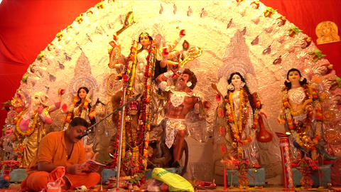 Hindu priest worshipping Goddess Durga Idol, Kolkata, West Bengal, India GIF