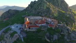 Aerial: camera smoothly flying around Treskavec monastery in Macedonia ビデオ