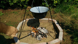 4K Outdoor Cooking by Open Fire in the Summer Footage