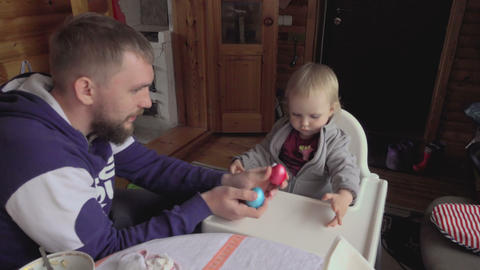 Young father with his daughter Easter breakfast Footage