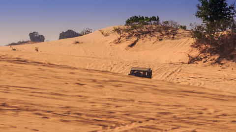 Jeeps Run down in Sand Racing Disappear in Sand Dunes GIF