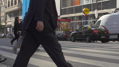 People crossing the street in downtown Buenos Aires in slow motion series 5 Footage