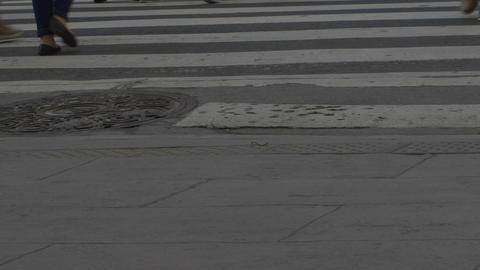 Feet crossing the street in downtown Buenos Aires series 1 Footage