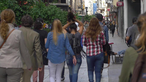 People walking trough Florida Street downtown Buenos Aires in slow motion Footage