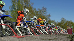 start a large group of riders motorcyclists Footage