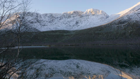 Beautiful mountain landscape. Reflection in a clear lake. Panorama Footage