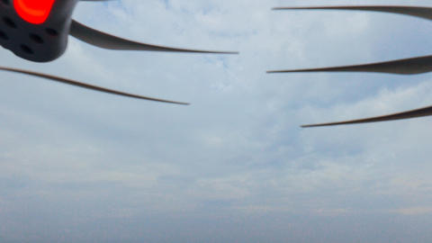 propellers of a drone flying in the blue sky Photo