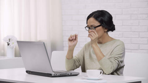 Adult asian female wearing glasses, typing on laptop, sending email to daughter Live Action
