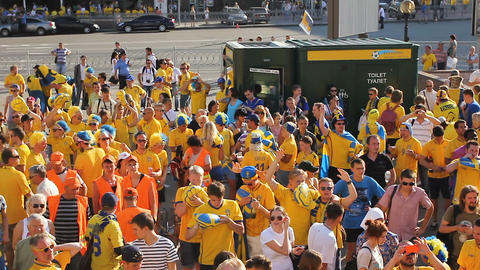 KYIV, UKRAINE - CIRCA JUNE 2012: Football supporters in the city. Top view of Live Action