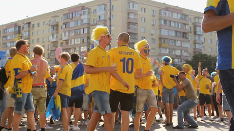KYIV, UKRAINE - CIRCA JUNE 2012: Football supporters in the city. Fans of Footage