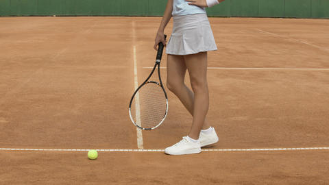 Female athlete with perfect body training before tennis match on the court Footage