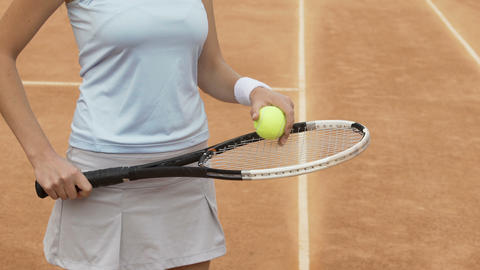 Female tennis player bouncing ball on racket, healthy lifestyle and sports hobby Live Action