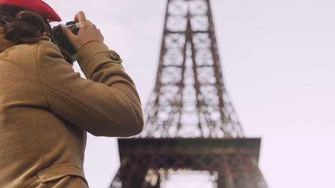 Curious female tourist photographing Eiffel Tower, tourism, vacation in Paris Footage