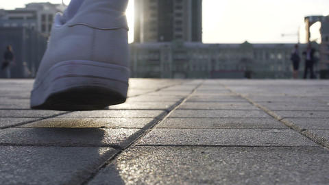 Close up of male legs moving in white sneakers, sport footwear advertisement Live Action