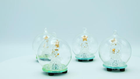 Loopable glass Christmas Trees inside glass ball on white background Footage