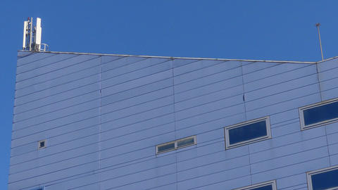 Powerful Cell Transmission Antena On Top of Corporate Building Footage