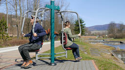 Man and woman exercising in an outdoor gym Footage