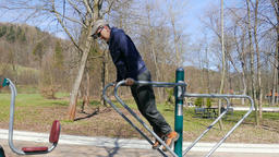 Man is exercising in an outdoor gym Footage