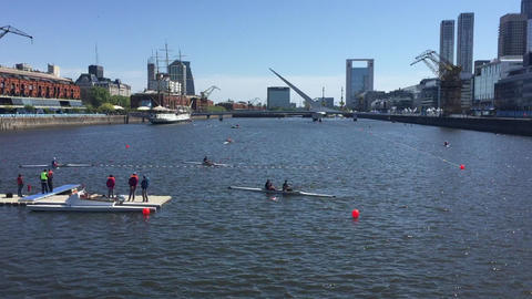 Row boats and kayaks traffic in harbor lanes for the Buenos Aires Youth Olympic GIF