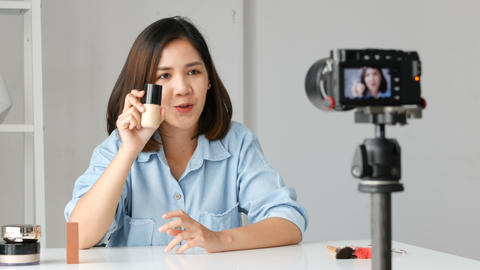 Young asian woman influencer beauty fashion blogger recording video Presen her Footage
