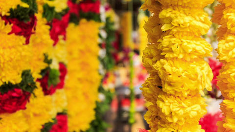 Wind Shakes Yellow and Red Flower Garlands Footage