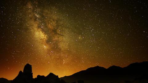 Volcanic Rock Formation LM09 Timelapse Night Sky to Sunrise Tilt Up Footage