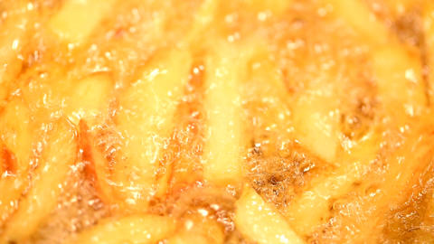 Preparing French Fries In Hot Boiling Oil With Fresh Potato Chips Footage