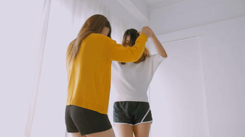 Young asian female lesbian couple dancing at bedroom. Lifestyle friendship Live Action