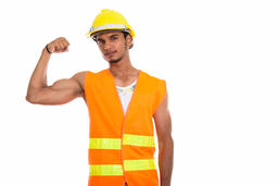 Studio shot of young handsome Indian man construction worker fle Photo