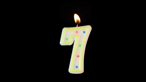 Candle number 7 burning - birthday! Transparent background Footage