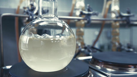 Boiling liquid in a flask in the laboratory Footage