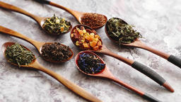Spoons with different types of dry tea leaves ビデオ
